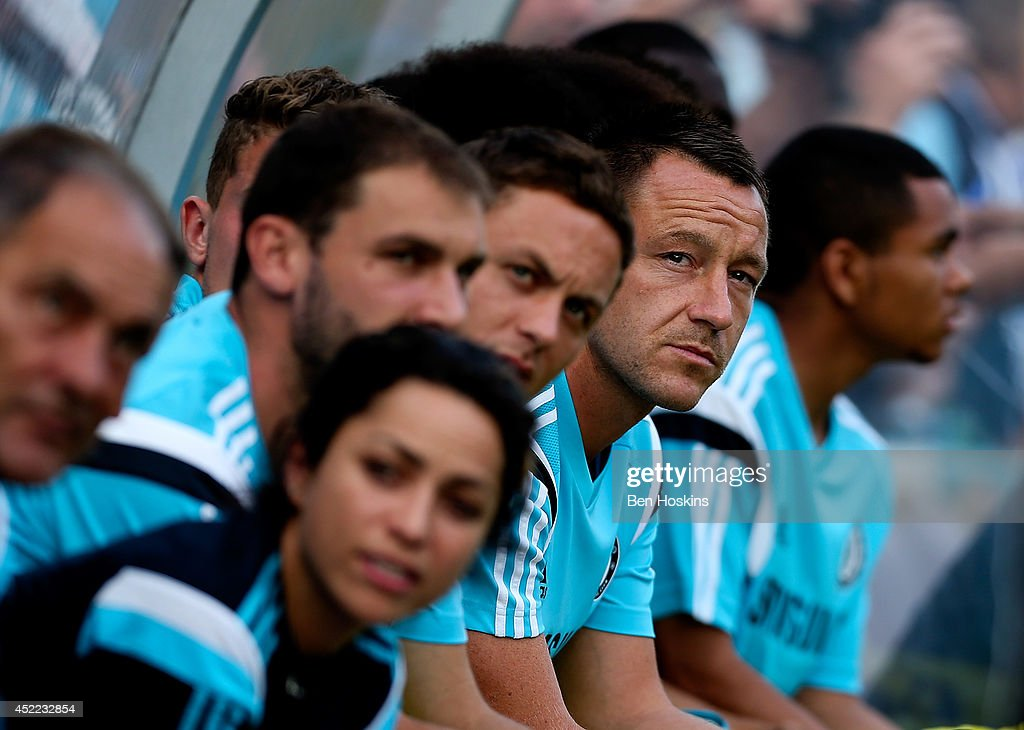John Terry of Chelsea looks on from the bench prior to the pre season friendly match between Wycombe Wanderers and Chelsea at Adams Park on July 16, 2014 in High Wycombe, England.