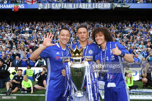 John Terry of Chelsea Nemanja Matic of Chelsea and David Luiz of Chelsea pose with the Premier League Trophy after the Premier League match between...