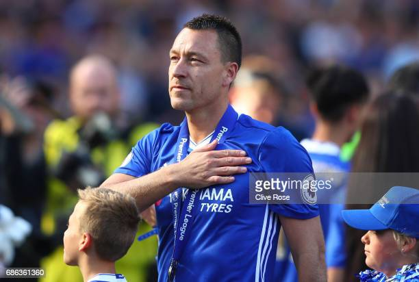 John Terry of Chelsea pats the Chelsea badge on his shirt after the Premier League match between Chelsea and Sunderland at Stamford Bridge on May 21...