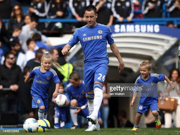 John Terry of Chelsea plays football with his daughter Summer Rose Terry and son Georgie Terry during the Barclays Premier League match between...