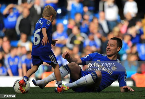 John Terry of Chelsea plays football with his son Georgie Terry during the Barclays Premier League match between Chelsea and Blackburn Rovers at...