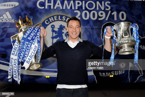 John Terry of Chelsea poses with the Premier League and FA Cup trophies prior to the Chelsea Football Club Victory Parade on May 16 2010 in London...