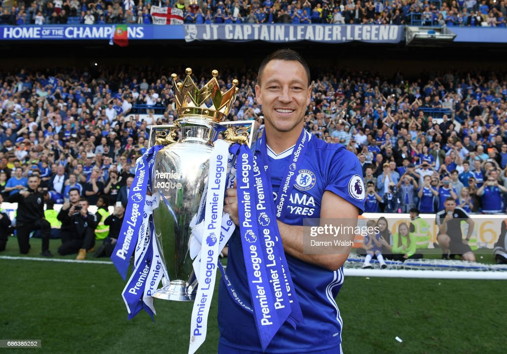 John Terry of Chelsea poses with the Premier League Trophy after the Premier League match between Chelsea and Sunderland at Stamford Bridge on May 21, 2017 in London, England.