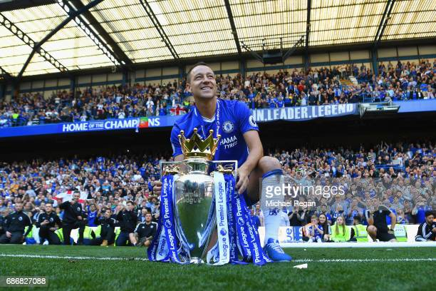 John Terry of Chelsea poses with the Premier League Trophy after the Premier League match between Chelsea and Sunderland at Stamford Bridge on May 21...