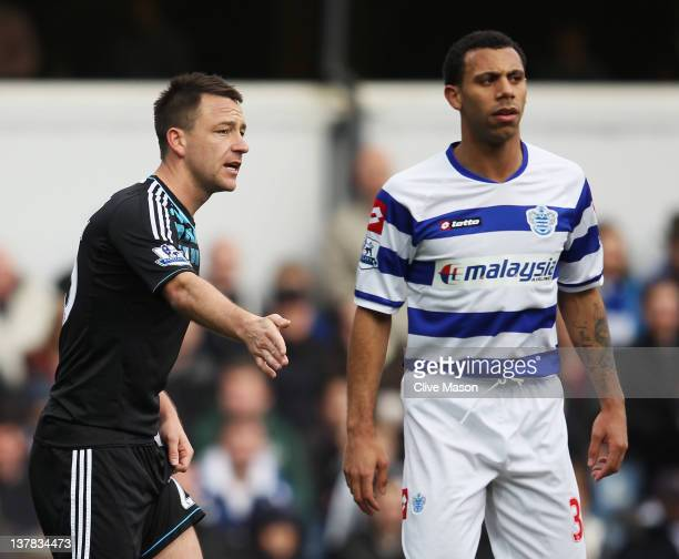 John Terry of Chelsea prepares to defend a corner with Anton Ferdinand of Queens Park Rangers during the FA Cup with Budweiser Fourth Round match...