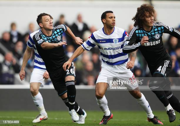 John Terry of Chelsea prepares to defend a cross with Anton Ferdinand of Queens Park Rangers during the FA Cup with Budweiser Fourth Round match...
