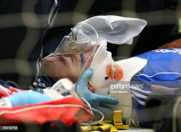John Terry of Chelsea receives treatment for a head injury during the Carling Cup Final match between Chelsea and Arsenal at the Millennium Stadium...