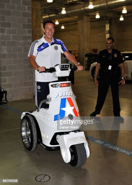 John Terry of Chelsea rides a police scooter after a training session at the Cowboys Stadium on July 25 2009 in Dallas Texas
