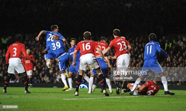 John Terry of Chelsea rises up to head the winning goal during the Barclays Premier League match between Chelsea and Mancester United at Stamford...