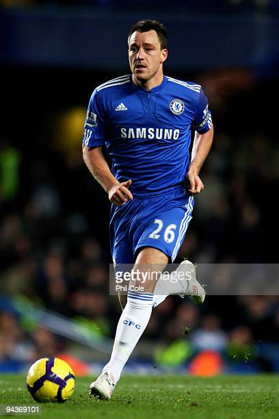 John Terry of Chelsea runs with the ball during the Barclays Premier League match between Chelsea and Everton at Stamford Bridge on December 12, 2009...