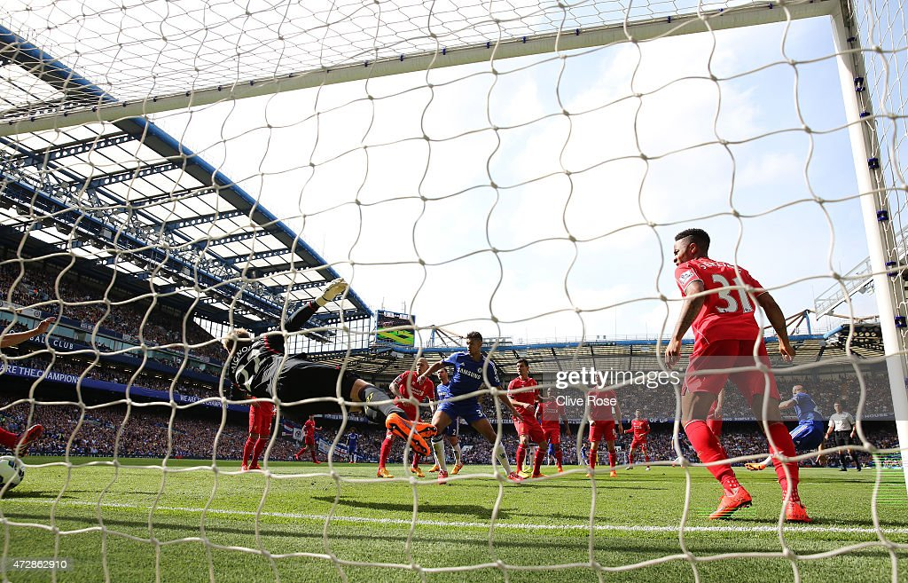 John Terry (R) of Chelsea scores the opening goal past the diving goalkeeper Simon Mignolet of Liverpool during the Barclays Premier League match between Chelsea and Liverpool at Stamford Bridge on May 10, 2015 in London, England.