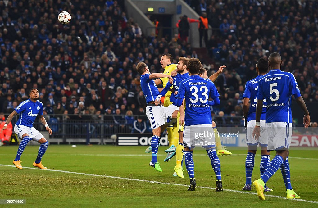 John Terry of Chelsea (C) scores their first goal with a header uring the UEFA Champions League Group G match between FC Schalke 04 and Chelsea FC at Stadion Gelsenkirchen on November 25, 2014 in Gelsenkirchen, Germany.