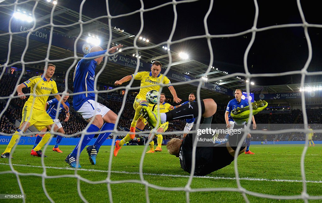 John Terry of Chelsea scores their second goal past Kasper Schmeichel of Leicester City during the Barclays Premier League match between Leicester City and Chelsea at The King Power Stadium on April 29, 2015 in Leicester, England.
