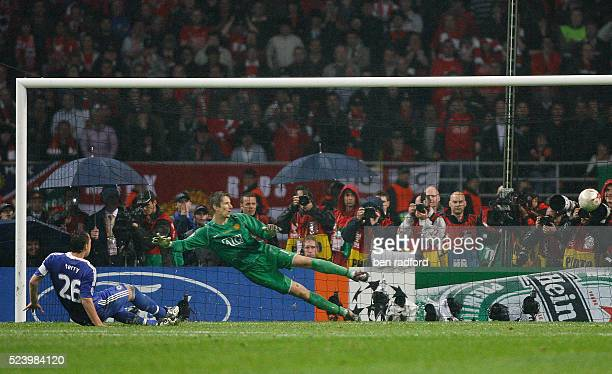 John Terry of Chelsea sends his penalty wide of the goal as Edwin Van Der Sar of Manchester United dives during the UEFA Champions League Final...
