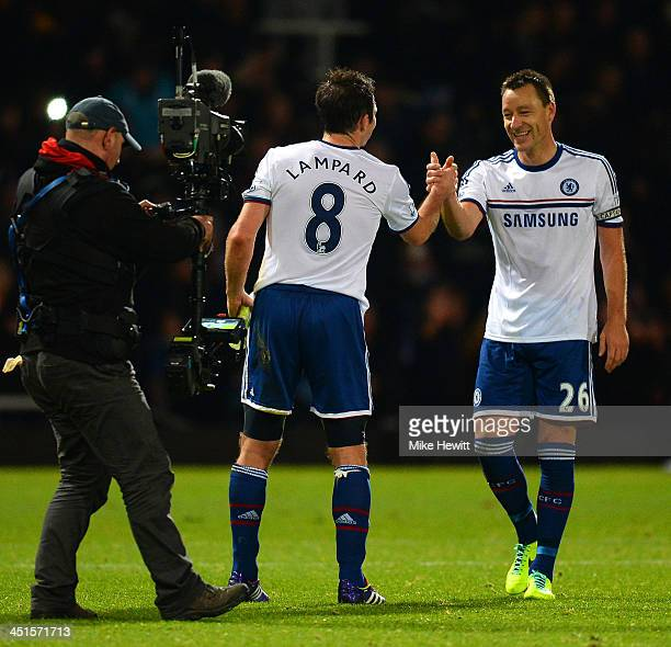 John Terry of Chelsea shakes hands with Frank Lampard of Chelsea at the final whistle during the Barclays Premier League match between West Ham...