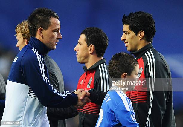 John Terry of Chelsea shakes hands with Luis Suarez of Liverpool during the Barclays Premier League match between Chelsea and Liverpool at Stamford...