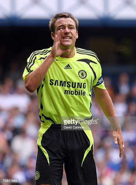 John Terry of Chelsea shouts directions to his teammates during the preseason friendly match between Glasgow Rangers and Chelsea held at Ibrox Park...