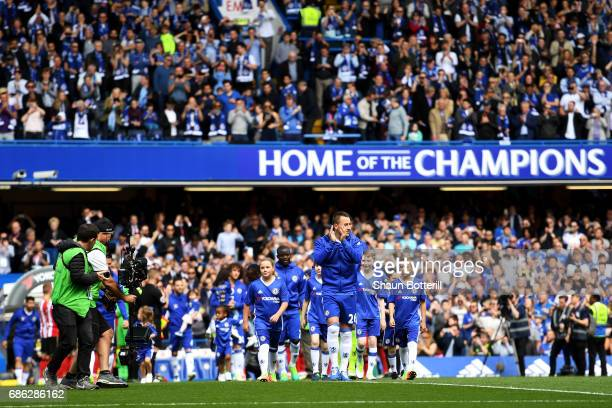 John Terry of Chelsea shows appreciation to the fans as he leads the team out prior to the Premier League match between Chelsea and Sunderland at...