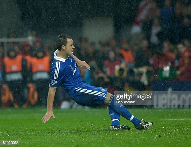 John Terry of Chelsea slips on the wet pitch while taking his penalty during the UEFA Champions League Final between Manchester United and Chelsea...