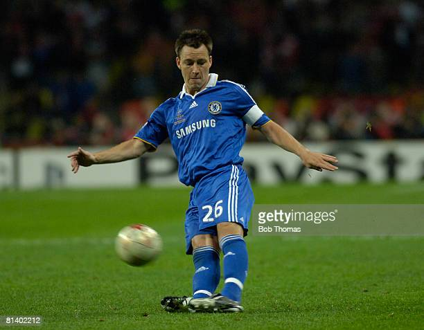 John Terry of Chelsea slips while kicking the ball during the UEFA Champions League Final between Manchester United and Chelsea held at the Luzhniki...