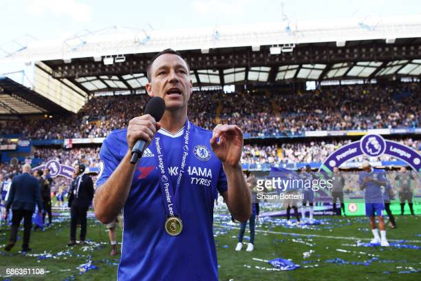 John Terry of Chelsea speaks to the Chelsea fans after the Premier League match between Chelsea and Sunderland at Stamford Bridge on May 21 2017 in...