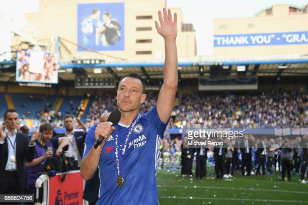 John Terry of Chelsea speaks to the crowd after the Premier League match between Chelsea and Sunderland at Stamford Bridge on May 21 2017 in London...