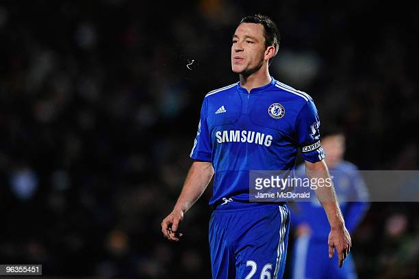John Terry of Chelsea spits during the Barclays Premier League match between Hull City and Chelsea at the KC Stadium on February 2 2010 in Hull...