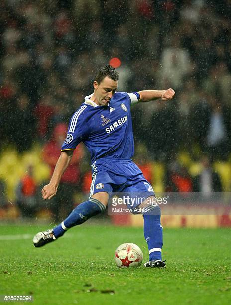 John Terry of Chelsea steps up to take a penalty during the shoot out before falling over and his shot saved by Edwin Van Der Sar of Manchester United