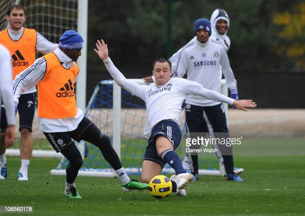 John Terry of Chelsea tackles Salomon Kalou during a training session at the Cobham training ground on November 5 2010 in Cobham England