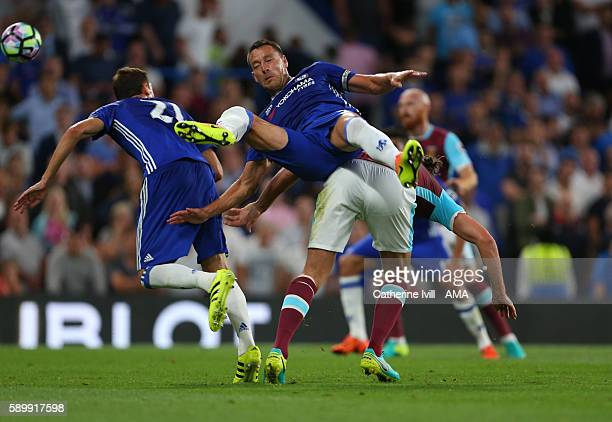 John Terry of Chelsea takes a tumble during the Premier League match between Chelsea and West Ham United at Stamford Bridge on August 15 2016 in...