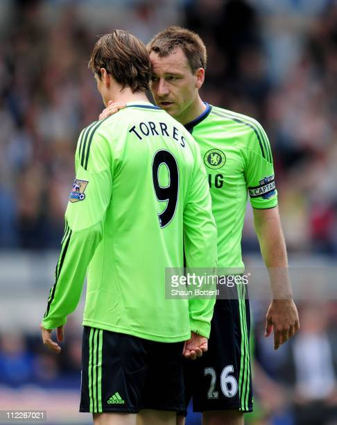John Terry of Chelsea talks with team mate Fernando Torres during the Barclays Premier League match between West Bromwich Albion and Chelsea at The...