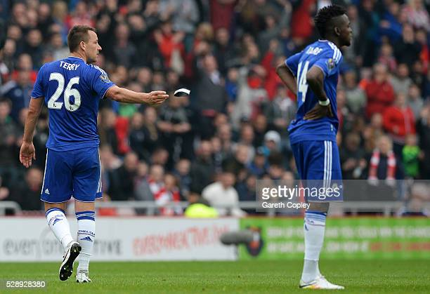 John Terry of Chelsea throws his captain's armband as he walks off the pitch after sent off during the Barclays Premier League match between...