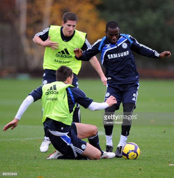 John Terry of Chelsea tried to tackl Gael Kakuta of Chelsea during a training session at Cobham training ground on November 20, 2009 in Cobham,...