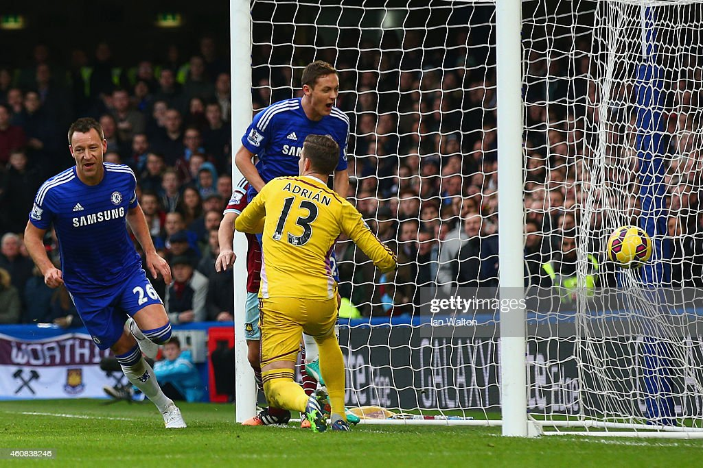 John Terry of Chelsea turns to celebrate after scoring the opening goal past Adrian of West Ham during the Barclays Premier League match between Chelsea and West Ham United at Stamford Bridge on December 26, 2014 in London, England.