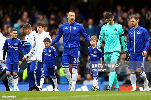 John Terry of Chelsea walks into the pitch prior to the Barclays Premier League match between Chelsea and West Ham United at Stamford Bridge on March...