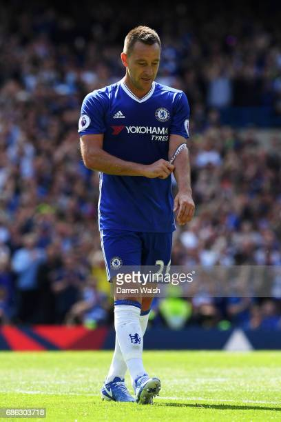 John Terry of Chelsea walks off the pitch as he is subbed during the Premier League match between Chelsea and Sunderland at Stamford Bridge on May 21...