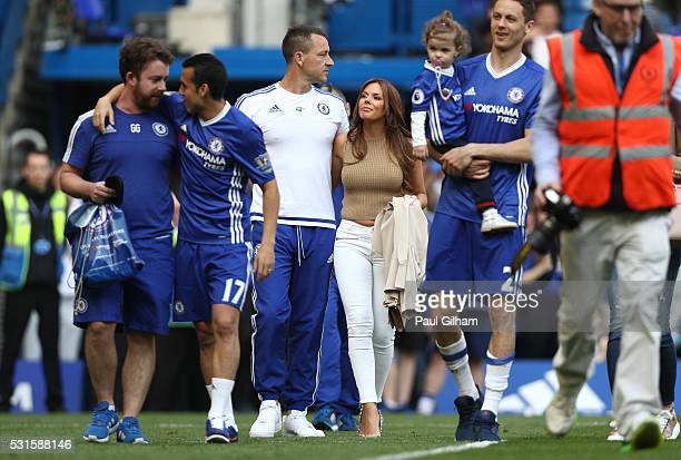 John Terry of Chelsea walks with wife Toni after the Barclays Premier League match between Chelsea and Leicester City at Stamford Bridge on May 15...