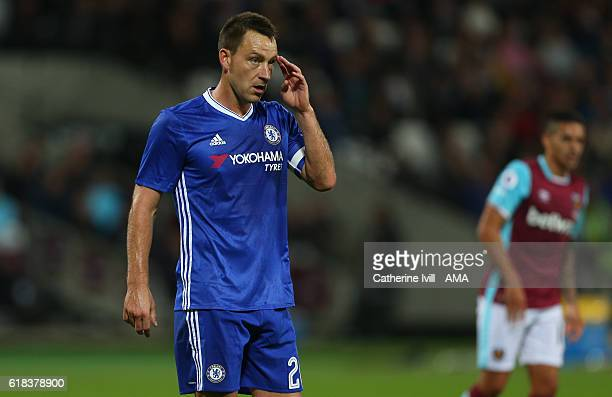 John Terry of Chelsea wipes his brow during the EFL Cup fourth round match between West Ham and Chelsea at The London Stadium on October 26 2016 in...