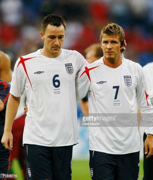John Terry of England and team mate David Beckham look dejected following their team's defeat in a penalty shootout at the end of the FIFA World Cup...