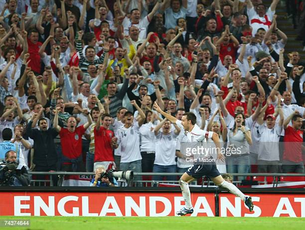 John Terry of England celebrates as he scores their first goal during the International Friendly match between England and Brazil at Wembley Stadium...