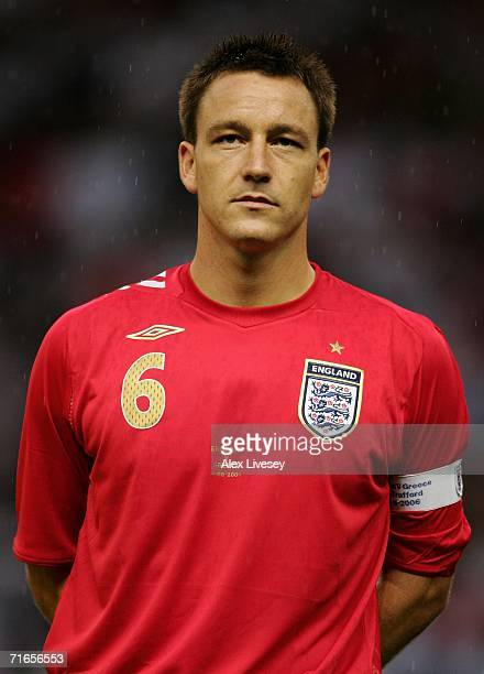John Terry of England lines up for the national anthems prior to the International Friendly match between England and Greece at Old Trafford on...