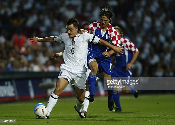 John Terry of England manages to hold off Niko Kovac of Croatia during the International Friendly match held on August 20 2003 at Portman Road in...