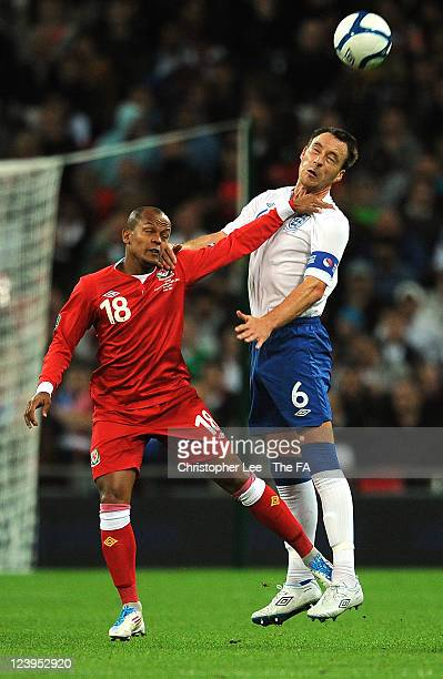 John Terry of England out jumps Robert Earnshaw of Wales during the UEFA EURO 2012 group G qualifying match between England and Wales at Wembley...