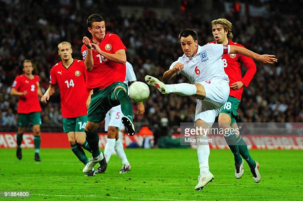 John Terry of England shoots on goal during the FIFA 2010 World Cup Qualifying Group 6 match between England and Belarus at Wembley Stadium on...
