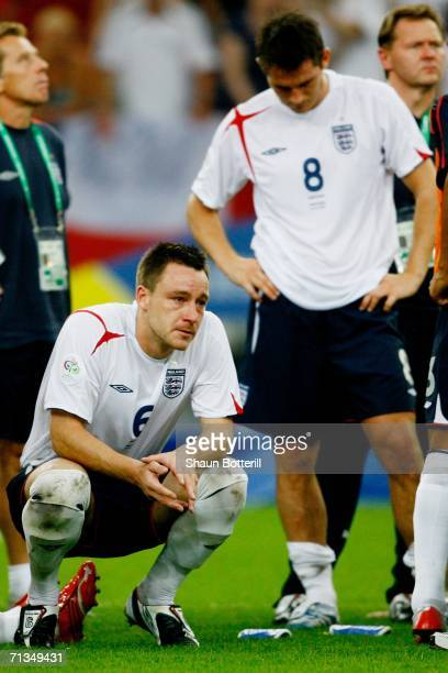 John Terry of England shows his dejection following his team's defeat in a penalty shootout at the end of the FIFA World Cup Germany 2006...