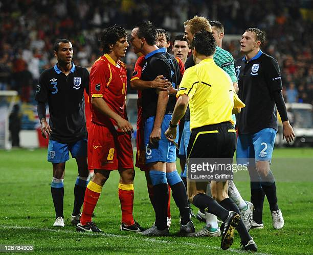 John Terry of England squares up to Stevan Jovetic of Montenegro during the UEFA EURO 2012 group G qualifier between Montenegro and England at the...