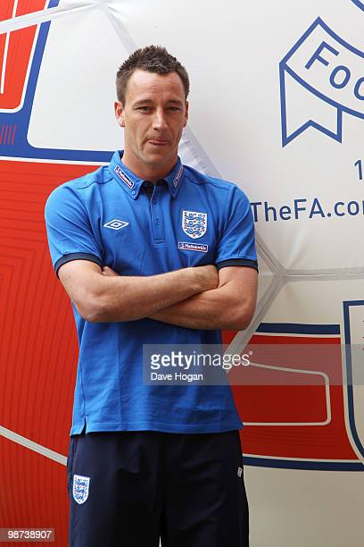 John Terry of England tackles a giant football at Wembley Stadium the event was to mark the launch of The FA's England Football Day and encourage...