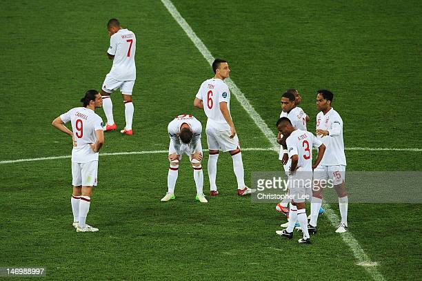 John Terry of England with team-mates after the UEFA EURO 2012 quarter final match between England and Italy at The Olympic Stadium on June 24, 2012...