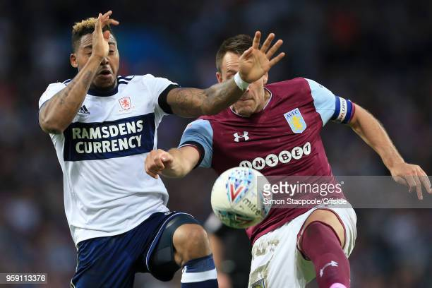 John Terry of Villa clears from Britt Assombalonga of Boro during the Sky Bet Championship Play Off Semi Final Second Leg match between Aston Villa...