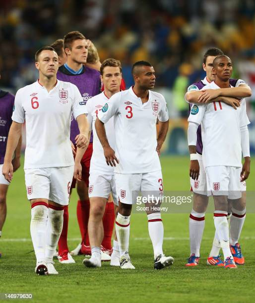 John Terry Scott Parker Ashley Cole and Ashley Young of England look dejected after the penalty shoot out during the UEFA EURO 2012 quarter final...